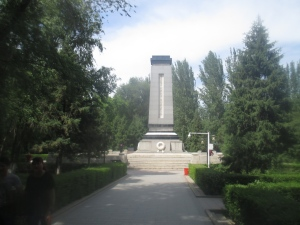 Monument, People's Park - while a Chinese memorial, it is written in Uighur script